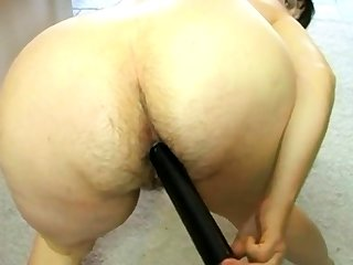 Mama fucks her hairy asshole
