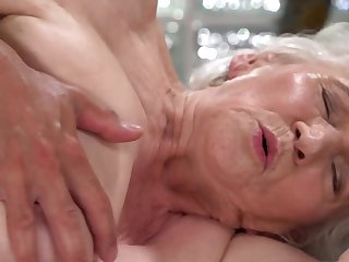 A nasty old granny is fucked on the side by a coxcomb really hard