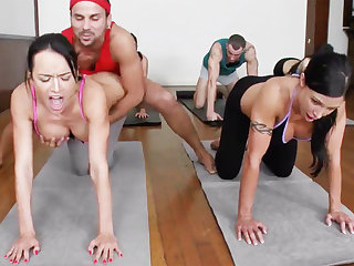 Lustful yoga beauties possessions fucked in a foursome