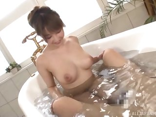 Oiled up Japanese babe Ayami Shunka gives a hot blowjob in the shower